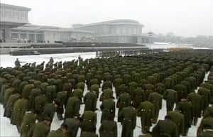 Kim Jong-il funeral: Military personnel bowing their heads
