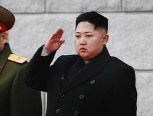 Kim Jong-il funeral: Kim Jong Il's youngest son and successor salutes during the funeral