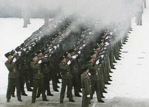 Kim Jong-il funeral: North Korean military personnel fire guns during the funeral