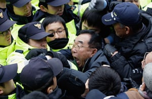 24 hours in pictures: Seoul: Activists try to enter the office of pro-unification group