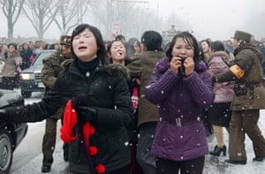 Kim Jong-il funeral: Mourners cry during the funeral procession