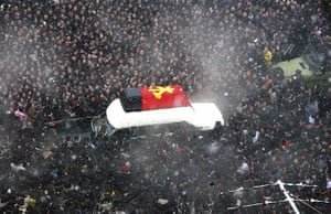 Kim Jong-il funeral: North Koreans surround the hearse