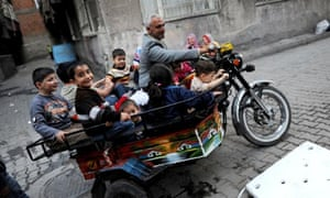 Kurdish children being driven around by motorbike in Diyarbakir