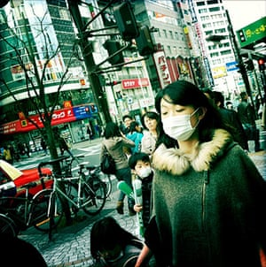 iPhone photos of the year: Local residents walk along the street in the Shinjuku district in Toyko