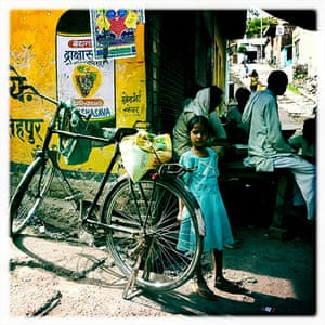 iPhone photos of the year: A young girl waiting on the streets near in Uttar Pradesh, India