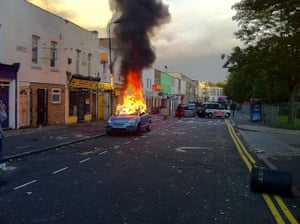 iPhone photos of the year: London, UK: A car burns during the Hackney Riots