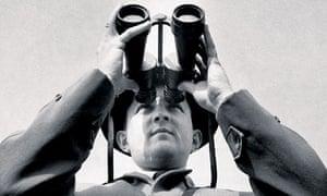 Peter Scott looking through binoculars