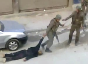 Camera phones: 10 November 2011: Troops dragging a body away in Damascus