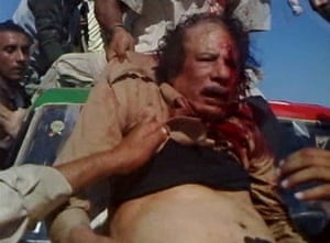 Camera phones: 20 October 2011: An NTC fighter pulls Muammar Gaddafi onto a vehicle