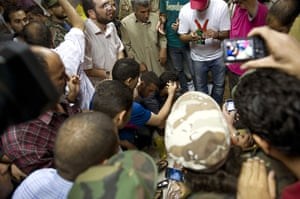 Camera phones: 20 October 2011: Libyans gather around the body of Colonel Muammar Gaddafi