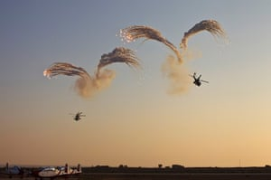 24 hours : Israel: Israeli Apache helicopters release flares at a graduation ceremony