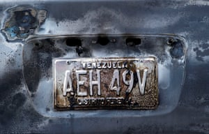 24 hours : Caracas, Venezuela: A plate of a burned-out car at the scene of an accident