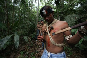 Yasuni National Park: A Waorani indigenous youth prepares to use his blowpipe