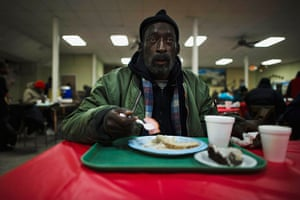 24 hours : Detroit, Michigan, USA: A man eats his lunch at the soup kitchen
