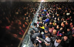 24 hours : Changsha, China: People queue up to buy train tickets at a railway station