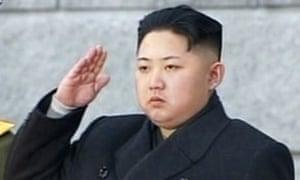 Kim Jong-un salutes during his father Kim Jong-il's memorial service