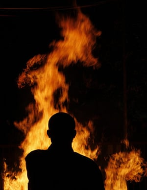 New Year celebrations: A monk stands in front of a fire in Tokyo