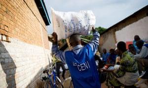 Congo election: man carries bag of ballots