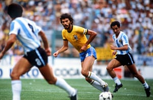 Socrates  : Socrates is chased by Osvaldo Ardiles of Argentina in the 1982 world cup