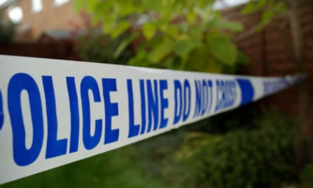 Police tape cordoning off a crime scene