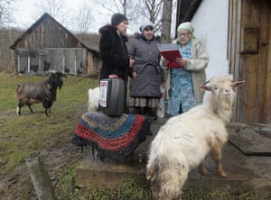 russia elections: A woman reads a ballot in Klukino
