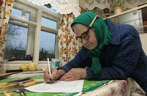 russia elections: A woman fills an voting form in her house in Gryaz