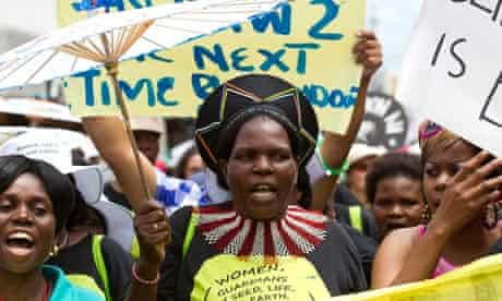 Environmental activists demonstrate outside the UN climate talks in Durban