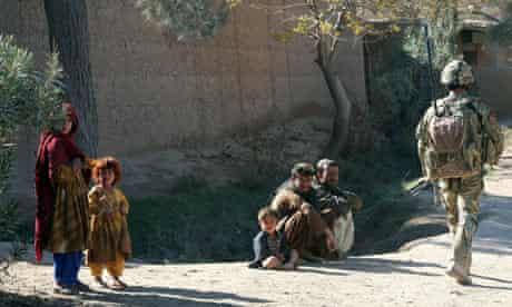 Nato soldier patrols in Nad Ali, Helmand, Afghanistan