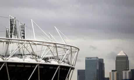 Canary Wharf is seen beyond the Olympic Stadium