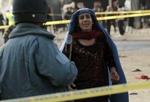 Kabul bombing: woman mourns
