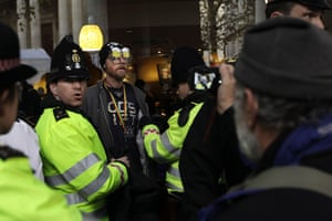 from the agencies: Police search an Occupy London protester