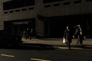 from the agencies: A city worker in front of a branch of Northern Rock