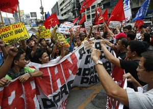 Occupy Mendiola: Protesters shout slogans as they converge at an intersection, Manila