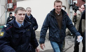 Alexey Navalny arrives for an appeal hearing at a court in Moscow