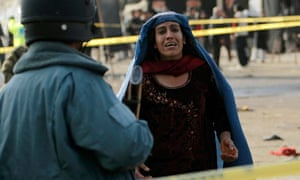 Afghan woman mourns after a suicide attack