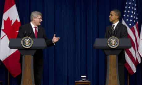 Stephen Harper, the Canadian prime minister, turns to Barack Obama after their meeting