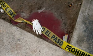 Tape used to cordon off a crime scene lies surrounded by blood in Ciudad Juarez