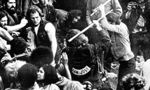 Hell Angels attacking fans at Rolling Stones concert at Altamont, California in 1969