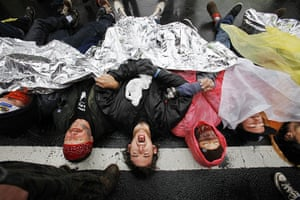 24 hours in pictures: Occupy DC protesters lay across K Street, Washington