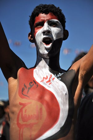 24 hours in pictures: Protester with Yemeni flag painted on his body shouts slogans
