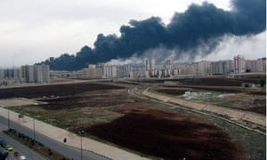 Black smoke rising from an oil pipeline in Homs