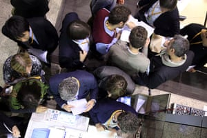 European Union Summit: A group of journalists gather arround a copy machine