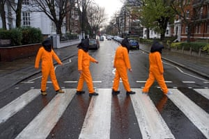 Stop The War: Guantanamo demonstrators Abbey Road zebra pedestrian crossing