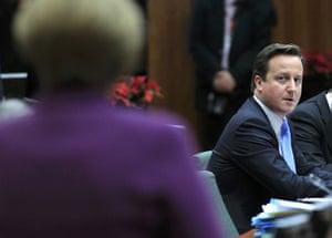 European Union Summit: David Cameron looks at Angela Merkel
