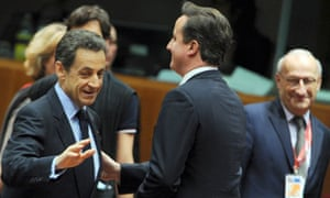 Nicolas Sarkozy and David Cameron before the start of a session during the European Union summit