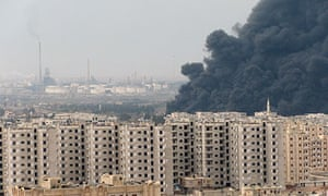 Syrian official news agency photo purporting to show black smoke enveloping Homs