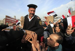 Egypt crisis day 8: An Egyptian policeman cries as he receives a warm welcome