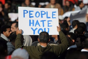 Egypt placards: A demonstrator holds a sign reading 'People hate you'