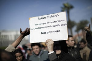 Egypt placards: An Egyptian protester holds a sign during a protest