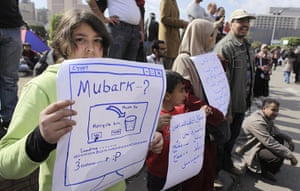 Egypt placards: A girl holds a poster during a demonstration in Cairo